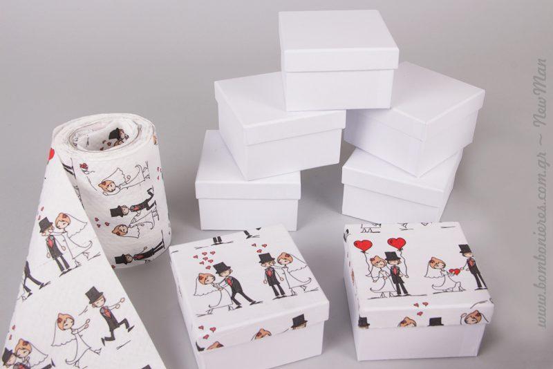 Με την μέθοδο ντεκουπάζ η Λίλιαν Νιούμαν μεταμόρφωσε τα χάρτινα λευκά κουτιά στην πιο αγαπησιάρικη μπομπονιέρα.