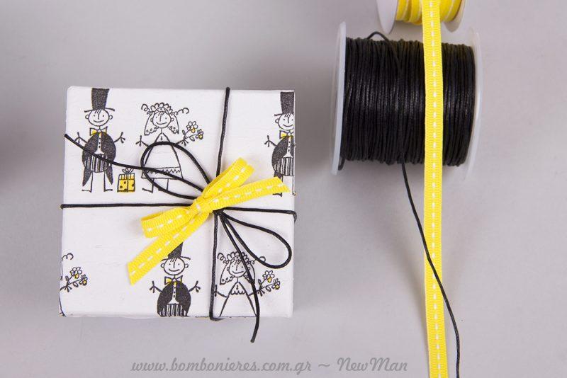 Μπομπονιέρα-κουτί σε κίτρινες αποχρώσεις.