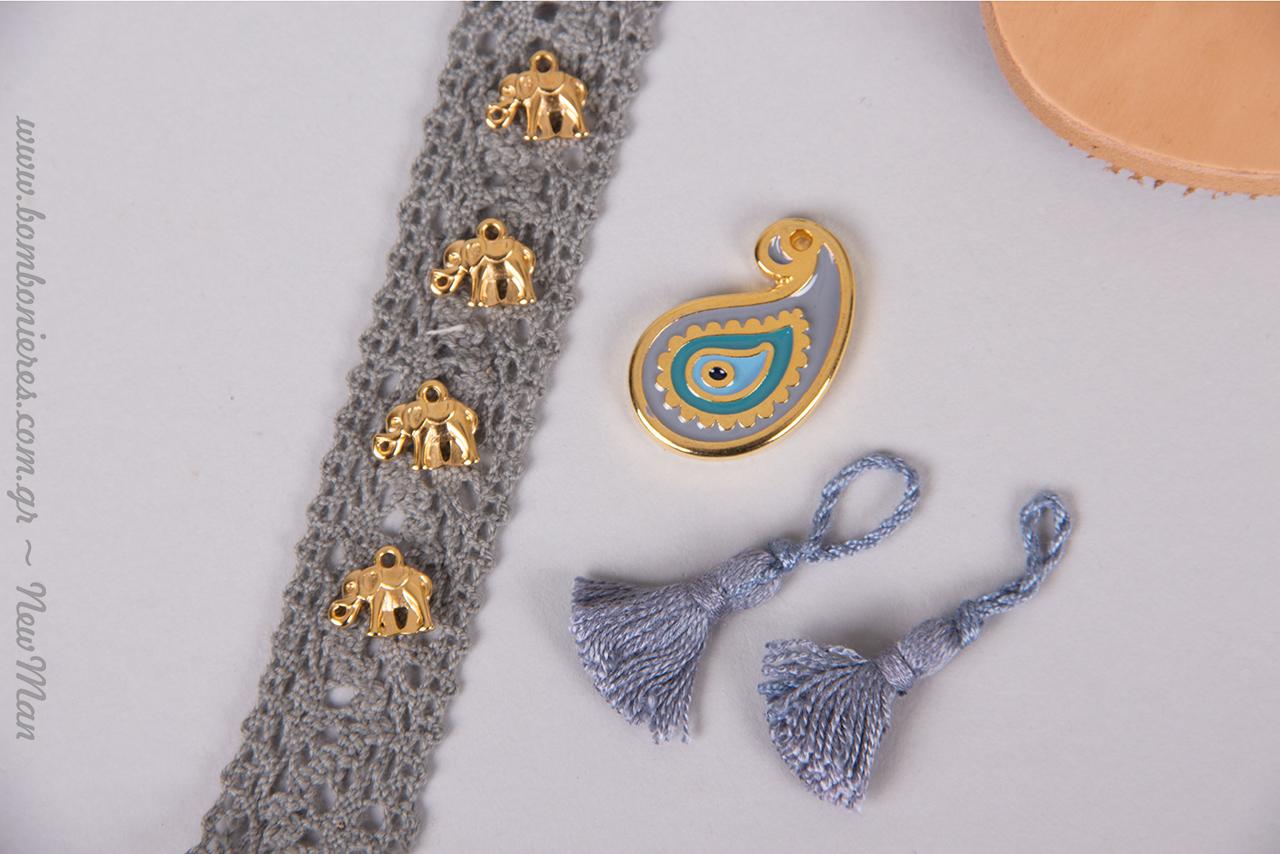 Ελεφαντάκια χρυσαφένια και λαχούρι μάτι για προστασία από το μάτιασμα και γκλάμουρ εμφάνιση.