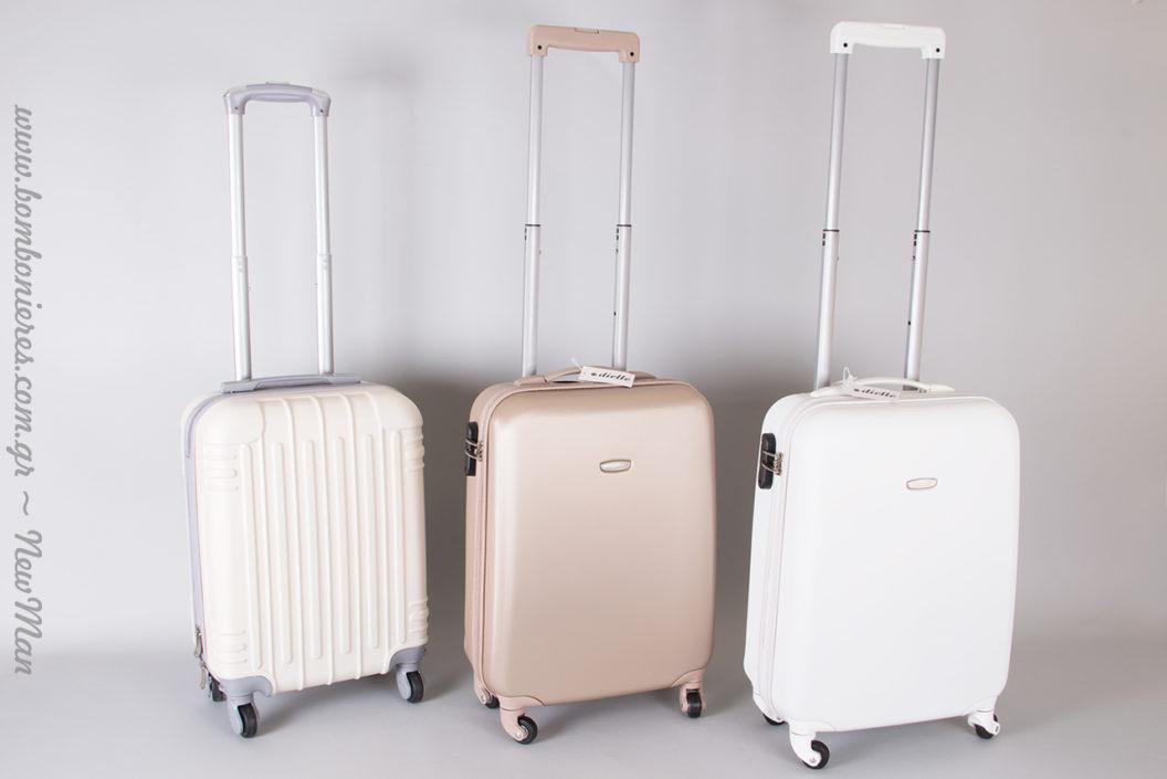 Βαλίτσες Dielle αντί του παραδοσιακού βαπτιστικού κουτιού σε τρεις ουδέτερες αποχρώσεις: σαμπανί, λευκό, γκρι-μπεζ.
