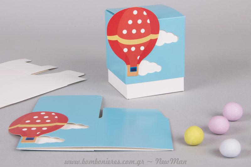 Χάρτινο κουτί με θέμα Αερόστατο και πολύχρωμα κουφέτα Χατζηγιαννάκης (Crispy) για τη μπομπονιέρα της βάπτισης.