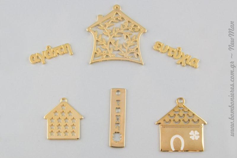 Μεταλλικά στοιχεία σε χρυσαφένια απόχρωση: σπίτι με αστεράκια, σπίτι με πέταλο, σπίτι με κλαδιά ελιάς, στήλη με γούρικα σύμβολα (688340) και ευχές.