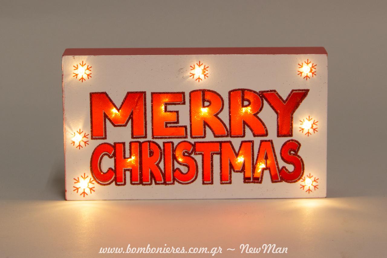 Κρεμαστή πινακίδα Merry Christmas με χιονονιφάδες (20 x 11 x 4cm) και φως Led για τη χριστουγεννιάτικη σας διακόσμηση.
