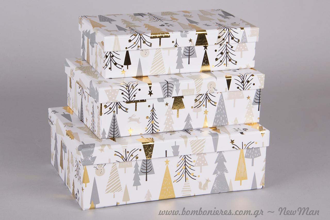 Ορθογώνια χάρτινα κουτιά σε χριστουγεννιάτικο σχέδιο και σε τρία διαφορετικά μεγέθη: 11x19x5cm, 13x20x6cm, 23x16x7cm.