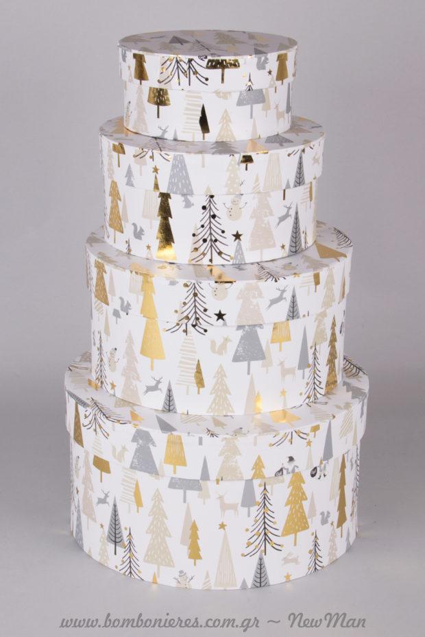 Χάρτινα στρογγυλά κουτιά σε χριστουγεννιάτικο σχέδιο και σε διάφορα μεγέθη (φ12x6cm, φ12x6cm, φ12x6cm, φ12x6cm).