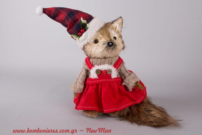 Διακοσμητική αλεπουδίτσα (25cm) που φοράει πουλόβερ, φόρεμα και σκούφο για τον χριστουγεννιάτικο στολισμό σας.