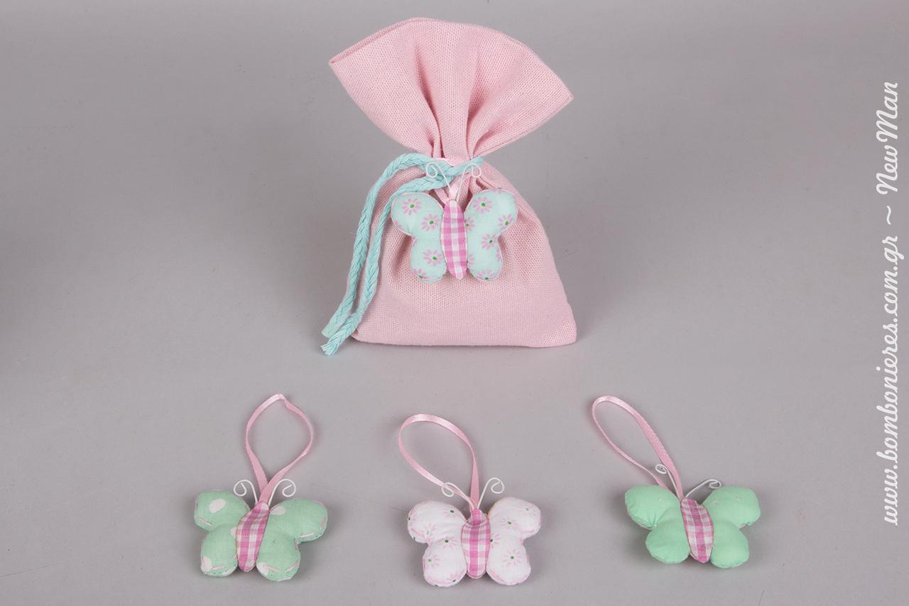 Θέμα πεταλούδα για τη βάπτιση της μικρής σας και πουγκί υφασμάτινο σε ροζ απόχρωση (13 x 18cm).